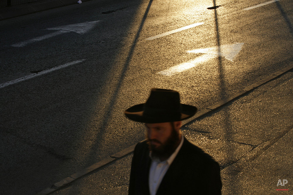 An ultra-Orthodox Jewish man walks in central Jerusalem at sunset, Wednesday, April 2, 2008. (AP Photo/Ed Ou)