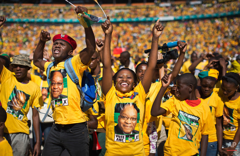 Excited supporters cheer for South African President Jacob Zuma at a final African National Congress (ANC) election rally in the Soweto township of Johannesburg, South Africa Sunday May 4, 2014. South African political parties held final campaign rallies Sunday ahead of elections on Wednesday, May 7, 2014 that are likely to see the ruling ANC return to power with a smaller majority due to voters disaffected by corruption in government and economic inequality. (AP Photo/Ben Curtis)
