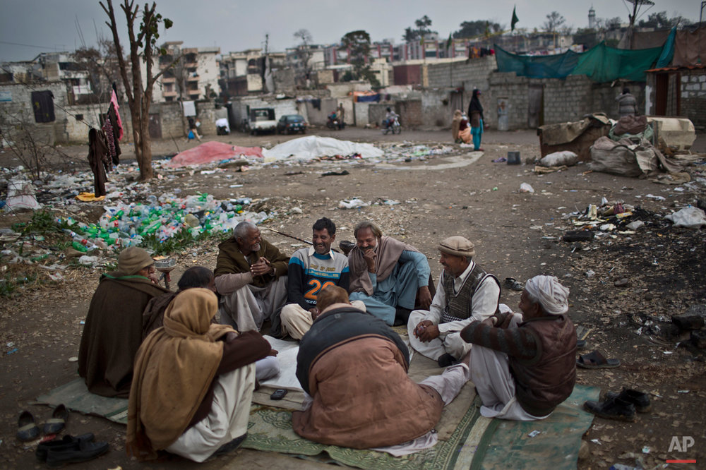 In this Tuesday, Feb. 3, 2015 photo,  Pakistani Christian men play cards at a slum home to Christian families in Islamabad, Pakistan. Most Christians face daily discrimination and eke out a living by holding low-paying jobs, like street sweeping. However, theyíve carved out their own lives in a country that faces near-daily attacks by Islamic extremists. (AP Photo/Muhammed Muheisen)