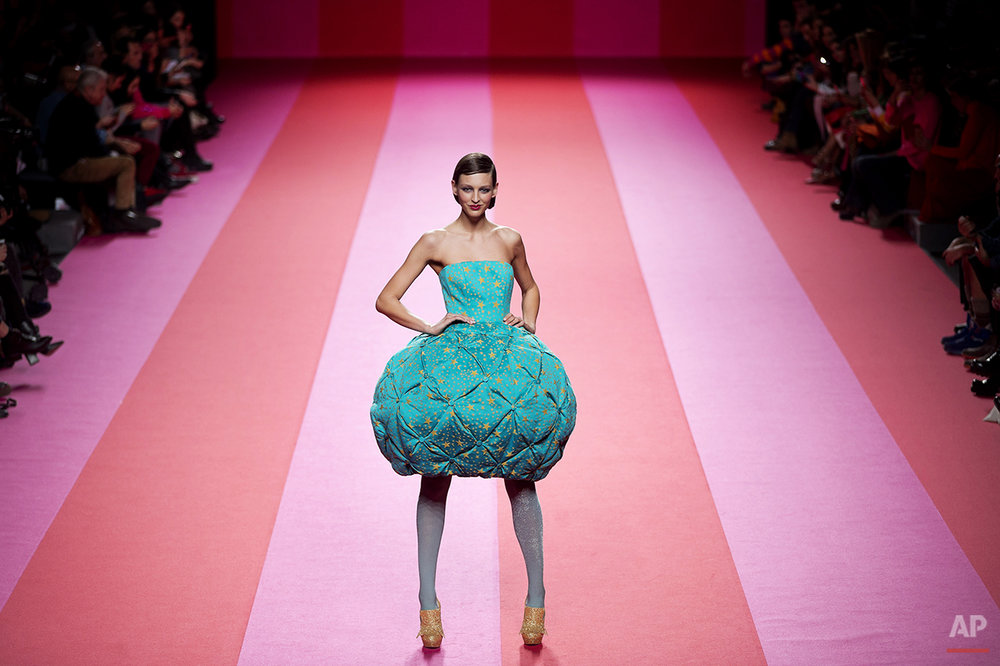 A model displays an Autumn/Winter designs by Agatha Ruiz De La Prada at Madrid's Fashion Week in Madrid, Spain, Tuesday, Feb. 10, 2015. (AP Photo/Daniel Ochoa de Olza)