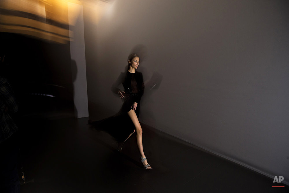 In this photo taken on Monday, Feb. 9, 2015, a model displays an Autumn/Winter design by Juanjo Oliva at Madrid's Fashion Week in Madrid, Spain. Madrid Fashion Week has celebrated its 30th anniversary with presentations from 44 designers and brands by models on catwalks in Spain's premier fashion showcase. (AP Photo/Daniel Ochoa de Olza)