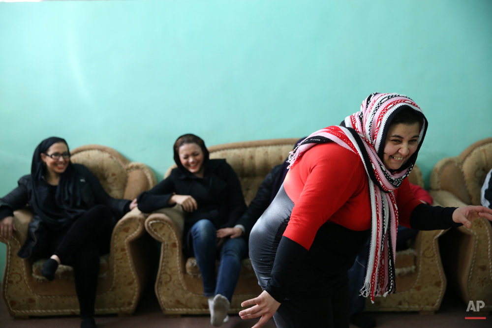In this Monday, Feb. 2, 2015 photo, female drug addicts play pantomime, at Chitgar treatment camp, in a mountain village northwest of Tehran, Iran. Anti-narcotics and medical officials say more than 2.2 million of Iran's 80 million citizens already are addicted to illegal drugs, including 1.3 million on registered treatment programs. They say the numbers keep rising annually, even though use of the death penalty against convicted smugglers has increased, too, and now accounts for more than nine of every 10 executions. (AP Photo/Ebrahim Noroozi)