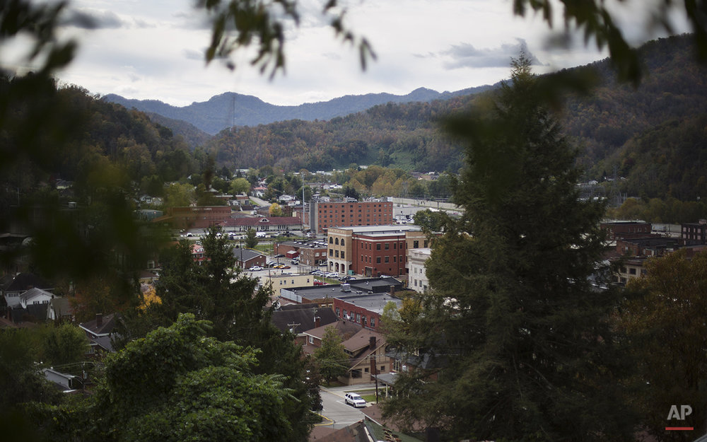 In this Oct. 20, 2014 photo, downtown streets are seen from a mountain top in Harlan, Ky. Harlan County's population has shrunk along with the coal industry, to around 28,000, its lowest since 1920. Many of those who remain are barely hanging on. (AP Photo/David Goldman)