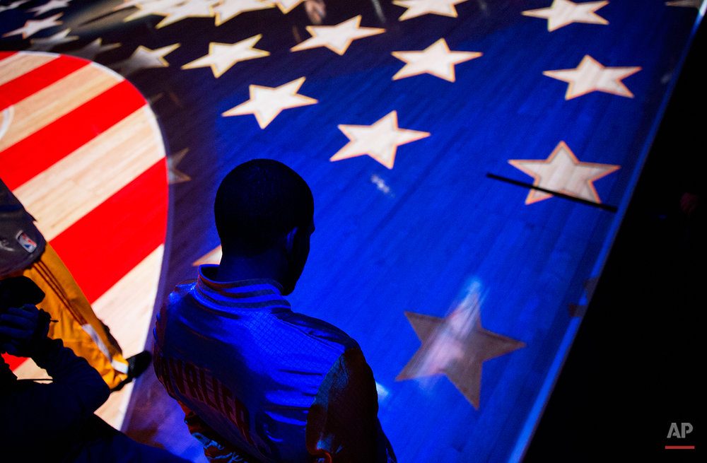 Cleveland Cavaliers' A.J. Price stands for the National Anthem before the start of an NBA basketball game against the Atlanta Hawks, Tuesday, Dec. 30, 2014, in Atlanta. (AP Photo/David Goldman)