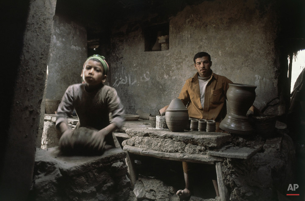 Potters at work in factories at South of Cairo, Egypt on March 14, 1981. (AP Photo/Bill Foley)