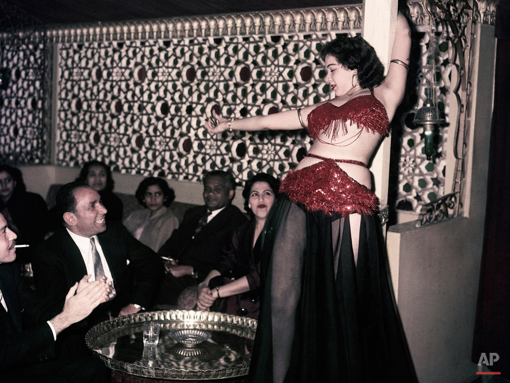 "In this March 25, 1956 photo, Ferial, a belly dancer, performs at the Abdin Casino in Cairo, Egypt. Egypt's top religious body has demanded Wednesday, Sept. 3, 2014 a new belly-dancing TV show be suspended for ""corrupting morals"" and serving ""extremists"" who could use it as a pretext to depict Egyptian society as anti-Islamic. (AP Photo)"