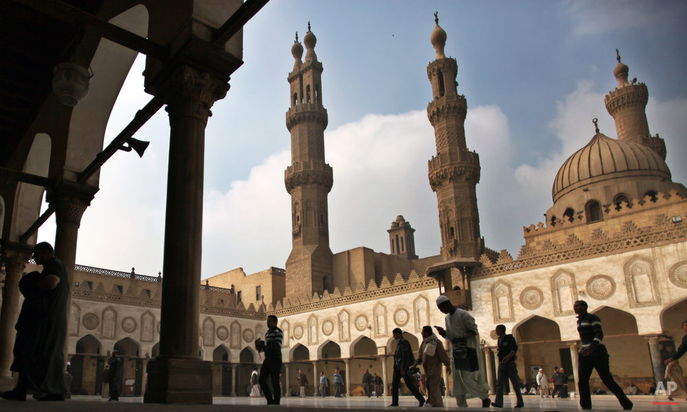 In this Friday, Dec. 28, 2012 photo, Muslims arrive to attend the Friday prayer at Al-Azhar mosque in Cairo, Egypt. Dar el-Ifta, the top Islamic authority in Egypt, revered by many Muslims worldwide, launched Sunday an internet-based campaign aimed particularly at the West against an extremist group in Syria and Iraq, saying it is not an ìIslamic State.î The Grand Mufti of Egypt, Shawki Allam, and clerics from the oldest Islamic learning institute, Al-Azhar, have condemned the Islamic State saying it was violating all Islamic principles and laws, describing it as a danger to the religion. (AP Photo/Khalil Hamra)