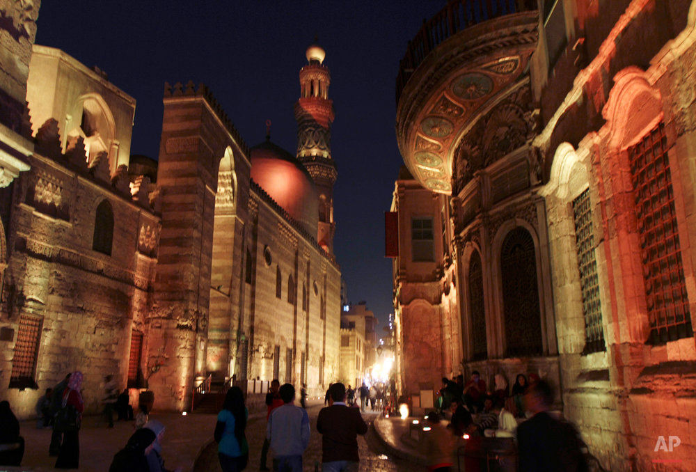 Egyptians walk in Al Muezz street in Al Azhar mosque area, in Cairo, Egypt, Tuesday, Dec. 7, 2010.  (AP Photo/ Khalil Hamra)