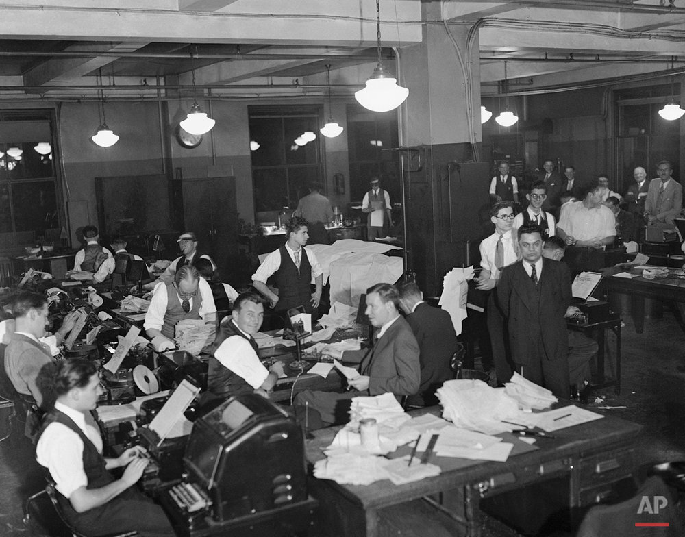 Workers are shown in the offices of the Associated Press on Election night, Nov. 8, 1932, in New York.  (AP Photo)