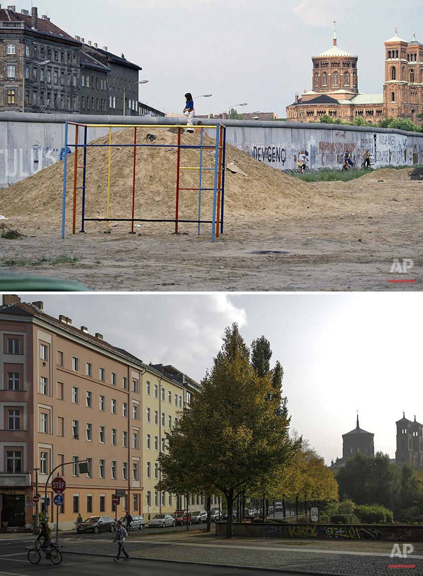 The combo shows a child playing on a play ground at the Berlin wall in July 1981 and cars parking at the same spot in Berlin's Kreuzberg district on Oct. 2, 2014 - 25 years after the fall of the wall. (AP Photo/Markus Schreiber)
