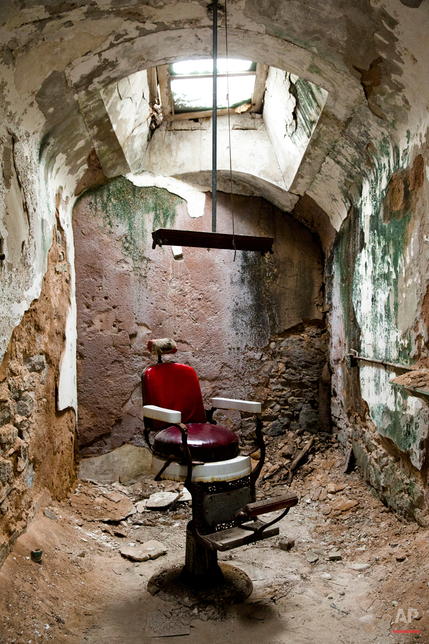 This Oct. 13, 2014, photo shows a barber shop in cellblock 10 at Eastern State Penitentiary in Philadelphia. The penitentiary took in its first inmate in 1829, closed in 1971 and reopened as a museum in 1994.  (AP Photo/Matt Rourke)