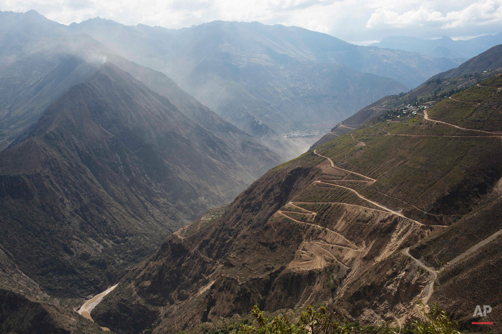 In this Oct. 28, 2014 photo, switch-back roads cover the mountains above the Mantaro river in Ayahuanco, Peru. Though the Shining Path was defeated two decades ago, cocaine-funded rebel remnants continue to hound Peruís security forces in the remote region. (AP Photo/Rodrigo Abd)