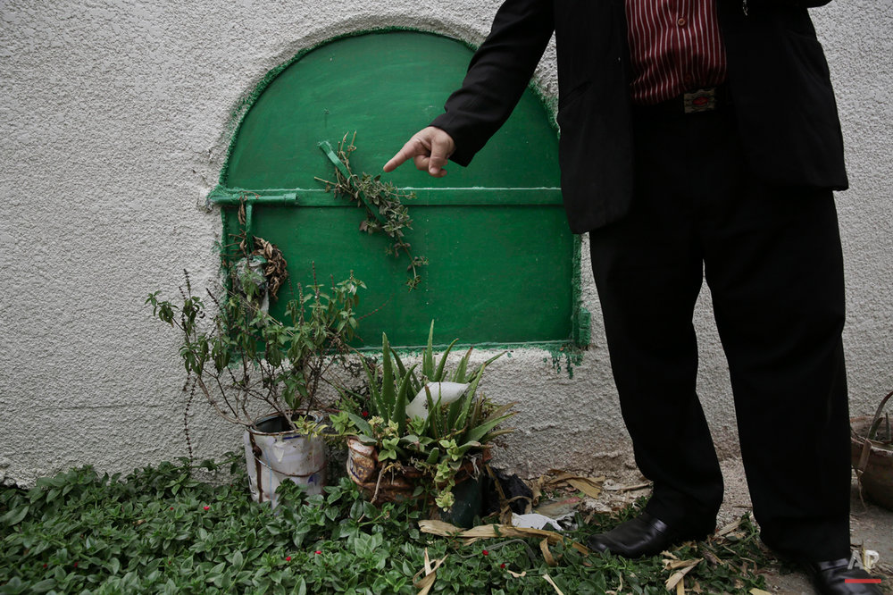 In this Wednesday, Nov. 5, 2014 photo, a man stands in front of the grave of 13-year-old Sohair el-Batea who died undergoing the procedure of female genital mutilation performed by Dr. Raslan Fadl, in Dierb Biqtaris village, on the outskirts of the town of Aga in Dakahliya,120 kilometers (75 miles) northeast of Cairo, Egypt. A verdict is expected Thursday, Nov. 20 in Fadlís trial. Rights advocates say the outcome of this case could set a key precedent for deterring doctors and families in the future. (AP Photo/Nariman El-Mofty)