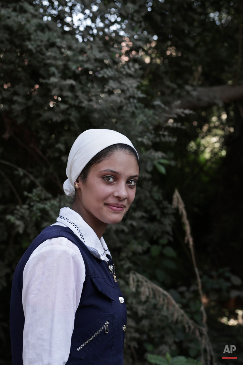 "In this Saturday, Nov. 15, 2014 photo, Hala Rateb, 18, a high school student, poses for a photograph in Sidfa, 340 kilometers (210 miles) south of Cairo, Egypt. ""I did not undergo the female genital mutilation operation. My mother who was forced into it did not want me to go through what she did."" (AP Photo/Nariman El-Mofty)"