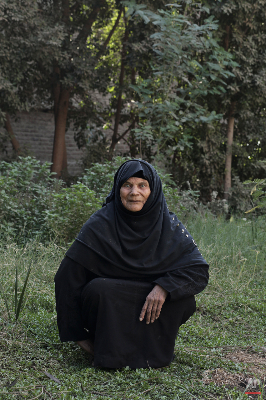 "In this Saturday, Nov. 15, 2014 photo, Ihsan Abdel Waly, 75, who worked as a midwife and has been subjected to female genital mutilation herself, poses for a photograph in Sidfa, 340 kilometers (210 miles) south of Cairo, Egypt. Abdel Waly started practicing in her early twenties. She learned from her mother who performed the procedure on her. ""During my mother's generation there were hardly any midwives. It was a mothers duty to perform the procedure to her own daughter. My generation was full of mid-wives. It became a job."" Abdel Waly is mother to four boys and one girl. She operated on her only daughter. ""I regret working as a midwife and operating on all these girls,"" she said. She feels it's her responsibility now to speak out against FGM. (AP Photo/Nariman El-Mofty)"