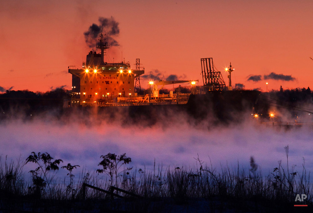 Arctic sea-smoke rises from Portland Harbor where the Bahama-based oil tanker, the Teesta Spirit, unloads it's fuel, Thursday, Jan. 24, 2013, in South Portland, Maine.  A stubborn cold front continues to grip the region. (AP Photo/Robert F. Bukaty)