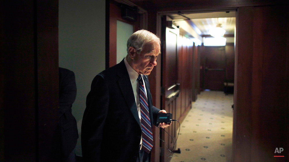 Republican presidential candidate, Rep. Ron Paul, R-Texas walks in a hallway before speaking at a campaign event, Thursday, Dec. 29, 2011, at the Hotel Pattee in Perry, Iowa. (AP Photo/Charles Dharapak)