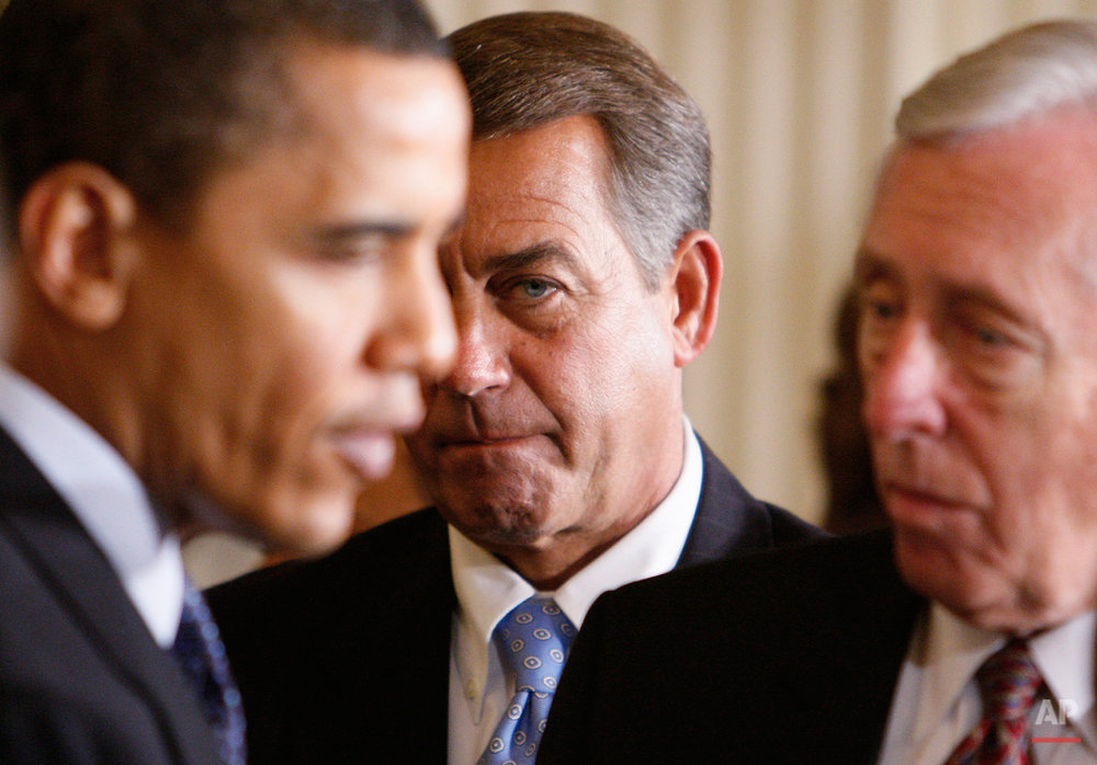 House Minority Leader John Boehner of Ohio, center, looks on as President Barack Obama, left, speaks with House Majority Leader Steny Hoyer of Md., after the president addressed lawmakers as he opened the Fiscal Responsibility Summit, Monday, Feb. 23, 2009, in the East Room of the White House in Washington.  (AP Photo/Charles Dharapak)