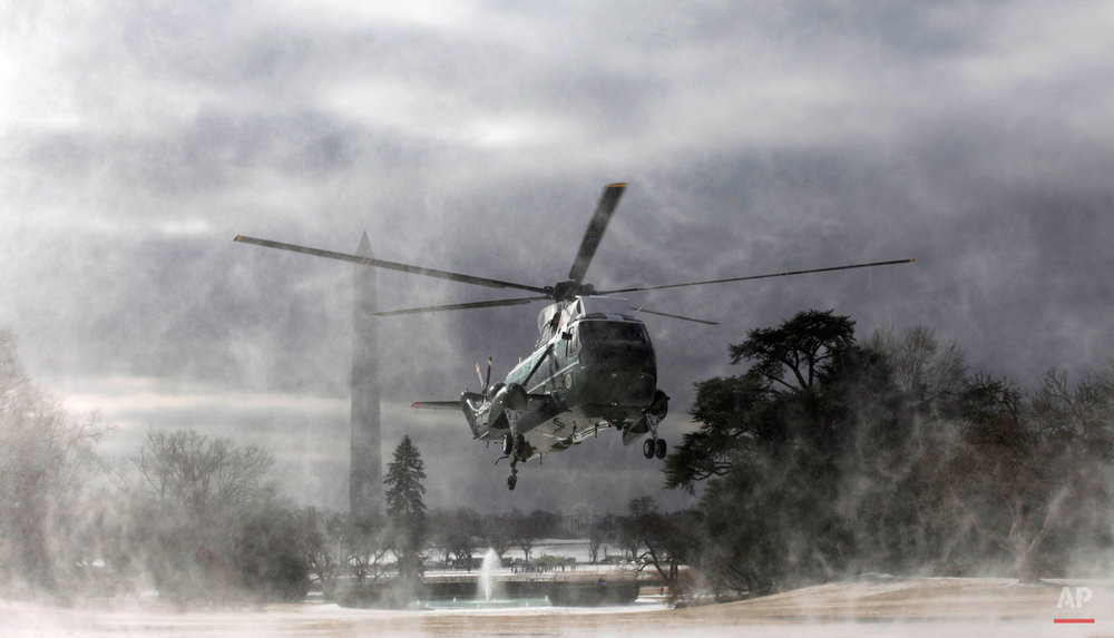The Marine One helicopter kicks up snow and ice as it lands on the South Lawn of the White House in Washington, Tuesday, Feb. 22, 2011, prior to President Barack Obama's departure to Cleveland, Ohio. (AP Photo/Charles Dharapak)