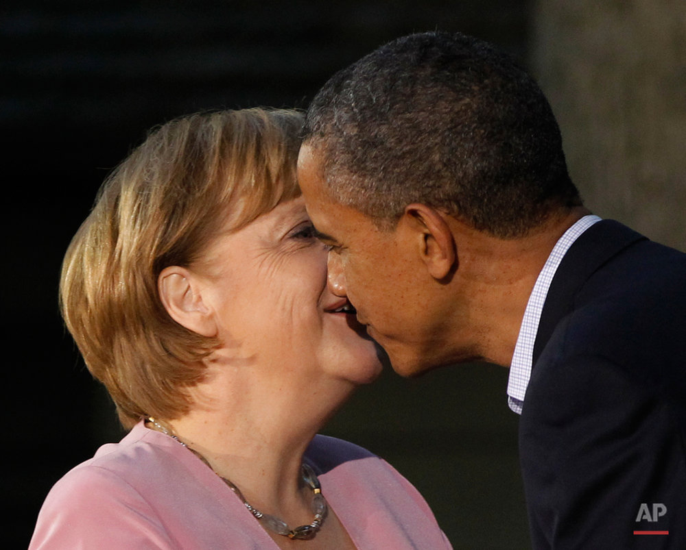 President Barack Obama gives German Chancellor Angela Merkel a kiss on the cheek on arrival for the G8 Summit Friday, May 18, 2012 at Camp David, Md. (AP Photo/Charles Dharapak)