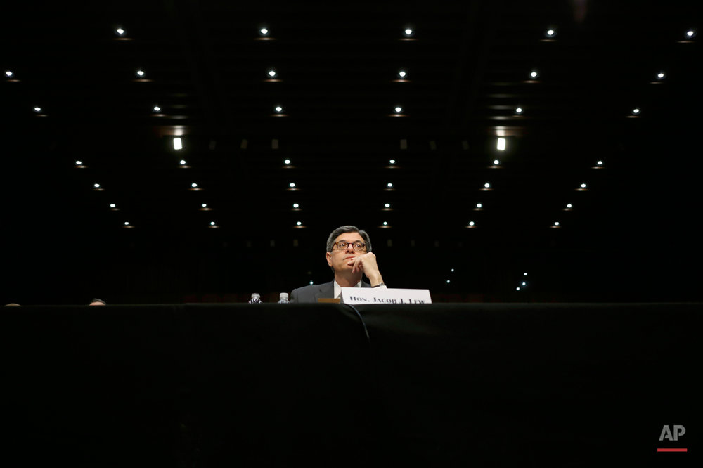Treasury Secretary Jacob Lew testifies on Capitol Hill in Washington, Wednesday, June 25, 2014, before the Senate Committee hearing to examine the Financial Stability Oversight Council annual report to Congress. (AP Photo/Charles Dharapak)