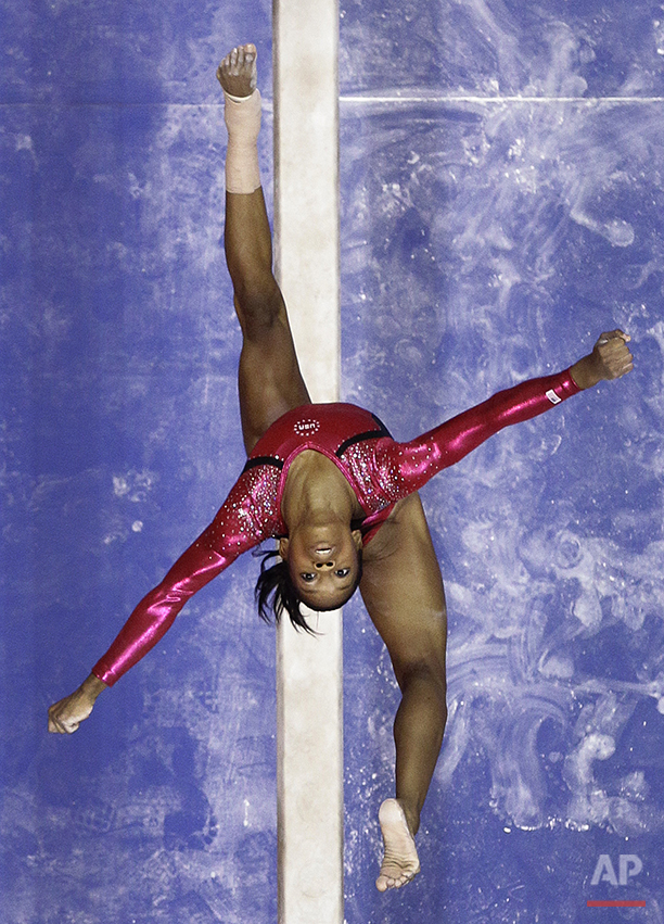 Gabby Douglas performs on the balance beam during the preliminary round of the women's Olympic gymnastics trials, Friday, June 29, 2012, in San Jose, Calif. (AP Photo/Julie Jacobson)