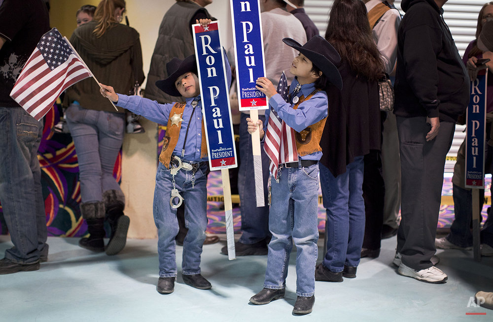 Angelo, left, and Nicholas Cocco, both 7, save Rep. Ron Paul, R-Texas memorabilia as they wait for their parents who stood in line to meet the Republican presidential candidate, Friday, Feb. 3, 2012, in Pahrump, Nev. (AP Photo/Julie Jacobson)