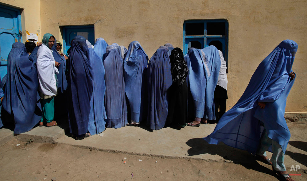 A woman leaves after casting her vote during the pariament elections in Kabul, Afghanistan, Saturday, Sept. 18, 2010. (AP Photo/Saurabh Das)