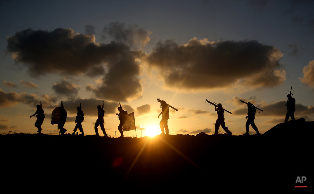 AP10ThingsToSee- Palestinian militants from Mujahideen Brigades, a small military group in Gaza, participate in a training session in Gaza City, Tuesday, June 10, 2014. (AP Photo/Hatem Moussa)
