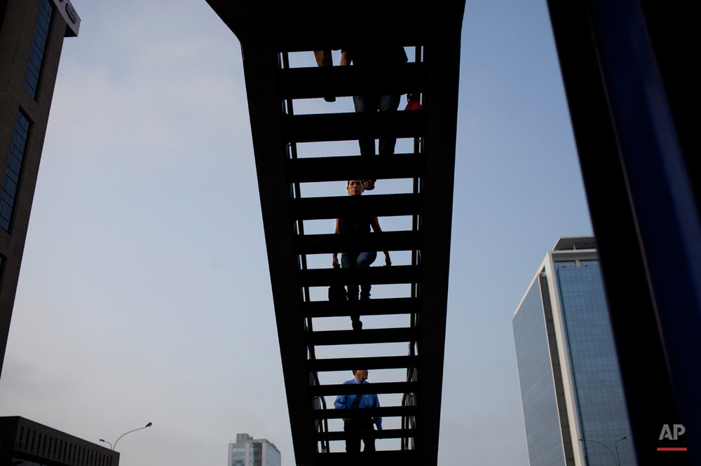 People climb the stairs in a public bus station in Lima, Peru, Thursday, Jan. 24, 2013. (AP Photo/Rodrigo Abd)