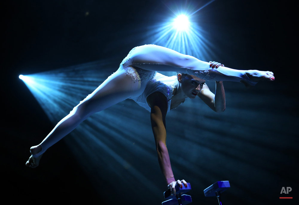 A member from the production Le Noir performs at the Marina Bay Sands on Tuesday March 12, 2013 in Singapore. Le Noir has a crew of twenty cirque performers from around the world like Russia, Australia, Lithuania, Canada, Bulgaria who specialize in different acrobatic acts, some of which were formerly from the production Cirque du Soleil. (AP Photo/Wong Maye-E)