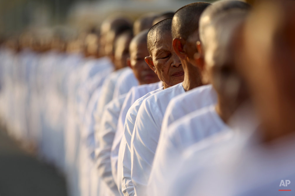 Hundreds of Buddhist nuns wait in line at the Royal Palace to pay their respects to the late former Cambodian King Norodom Sihanouk in Phnom Penh, Saturday, Feb. 2, 2013. Sihanouk's body had been lying in state at the Royal Palace after being flown from Beijing where he died Oct. 15 of a heart attack at the age of 89. The cremation, the climax of seven days of mourning, will take place Monday.(AP Photo/Wong Maye-E)
