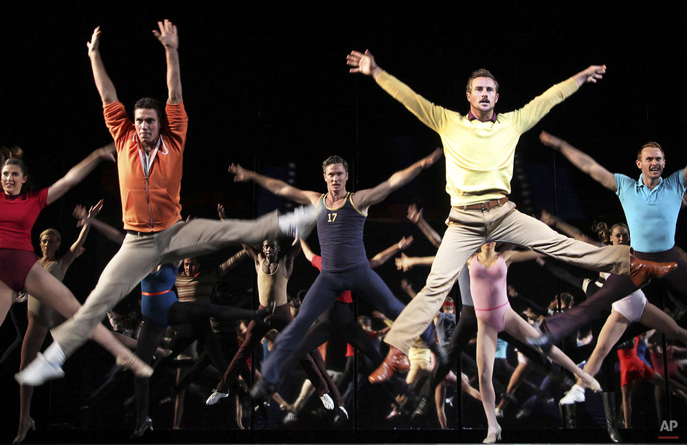 "Performers dance during a preview of American Broadway musical ""A Chorus Line"" at the Marina Bay Sands Theatre on Friday May 4, 2012 in Singapore. (AP Photo/Wong Maye-E)"
