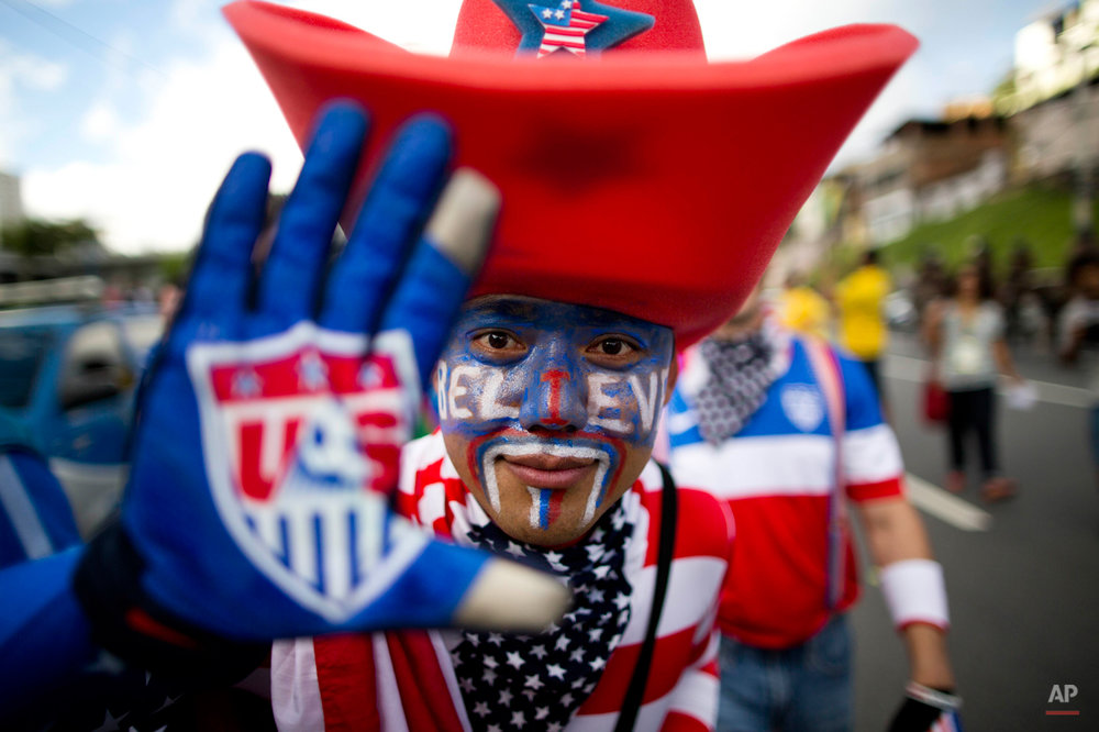 A soccer fan of the United States poses for the picture before World Cup round of 16 match between the U.S. and Belgium outside the Arena Fonte Nova stadium in Salvador, Brazil, Tuesday, July 1, 2014. (AP Photo/Rodrigo Abd)