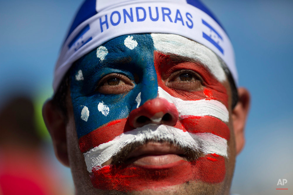 U.S. soccer fan Marco Antonio Sandoval, from Honduras, poses for the picture outside the Arena Fonte Nova stadium before World Cup round of 16 match between the US and Belgium in Salvador, Brazil, Tuesday, July 1, 2014. (AP Photo/Rodrigo Abd)