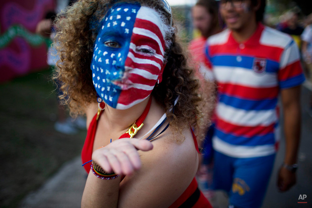 A soccer fan of the U.S. blows a kiss before a World Cup round of 16 match between the U.S. and Belgium, outside the Arena Fonte Nova stadium in Salvador, Brazil, Tuesday, July 1, 2014. (AP Photo/Rodrigo Abd)