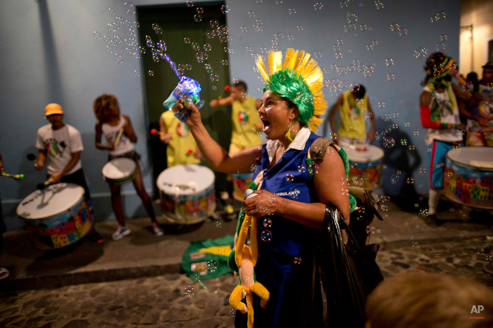 A woman sells toys in the Pelourinho neighborhood, near the Arena Fonte Nova in Salvador, Brazil, where U.S. and Belgium played a World Cup round of 16 match, Tuesday, July 1, 2014. Belgium beat the United States 2-1 in extra time to reach World Cup quarterfinals. (AP Photo/Rodrigo Abd)