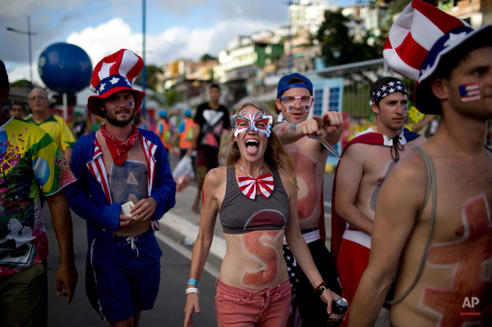 U.S. soccer fans celebrate before a World Cup round of 16 match between the U.S. and Belgium outside the Arena Fonte Nova stadium in Salvador, Brazil, Tuesday, July 1, 2014. (AP Photo/Rodrigo Abd)