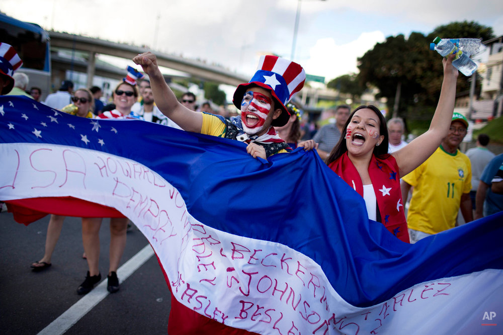 Soccer fans of the United States celebrate before a World Cup round of 16 match between the U.S. and Belgium outside the Arena Fonte Nova stadium in Salvador, Brazil, Tuesday, July 1, 2014. (AP Photo/Rodrigo Abd)
