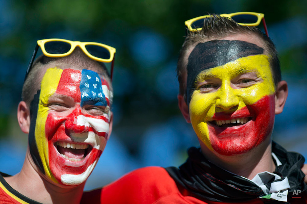 Belgium soccer fans poses for a picture before a World Cup round of 16 match between the U.S. and Belgium outside the Arena Fonte Nova stadium in Salvador, Brazil, Tuesday, July 1, 2014. (AP Photo/Rodrigo Abd)