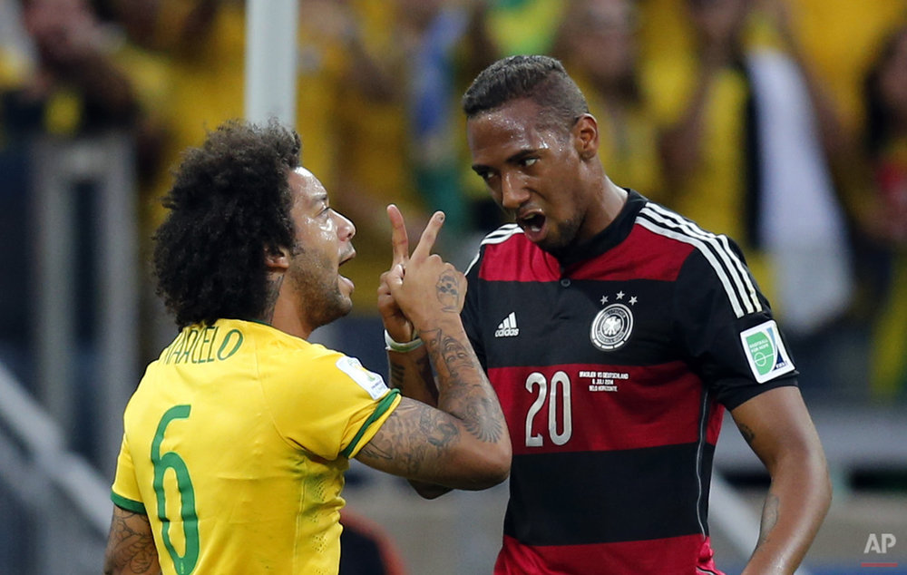 Brazil's Marcelo, left, and Germany's Jerome Boateng argue during the World Cup semifinal soccer match between Brazil and Germany at the Mineirao Stadium in Belo Horizonte, Brazil, Tuesday, July 8, 2014. (AP Photo/Frank Augstein)