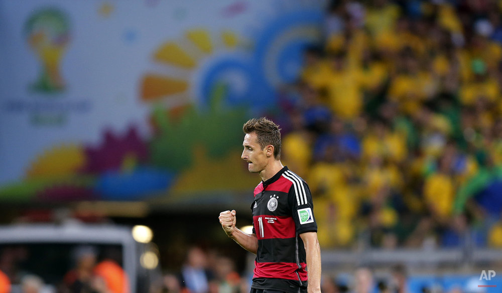 Germany's Miroslav Klose celebrates after scoring his side's second goal during the World Cup semifinal soccer match between Brazil and Germany at the Mineirao Stadium in Belo Horizonte, Brazil, Tuesday, July 8, 2014. (AP Photo/Frank Augstein)