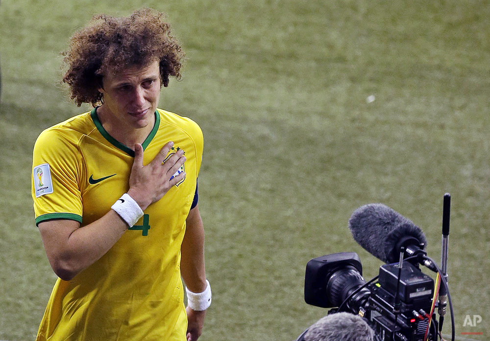Brazil's David Luiz leaves the pitch after the World Cup semifinal soccer match between Brazil and Germany at the Mineirao Stadium in Belo Horizonte, Brazil, Tuesday, July 8, 2014. Germany won 7-1.(AP Photo/Themba Hadebe)