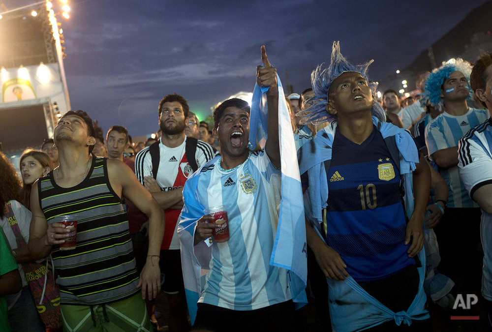 Argentina soccer fans watch a live broadcast of their team's World Cup semifinal match against Netherlands inside the FIFA Fan Fest area on Copacabana beach in Rio de Janeiro, Brazil, Wednesday, July 9, 2014. (AP Photo/Silvia Izquierdo)