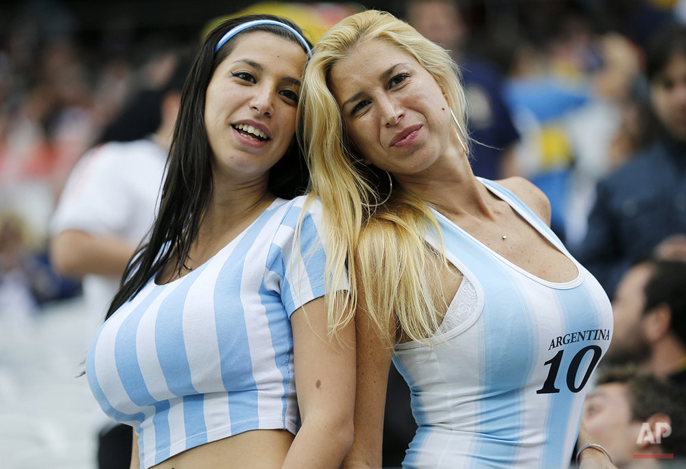 Argentina supporters pose for a photograph prior to the World Cup semifinal soccer match between the Netherlands and Argentina at the Itaquerao Stadium in Sao Paulo, Brazil, Wednesday, July 9, 2014. (AP Photo/Frank Augstein)