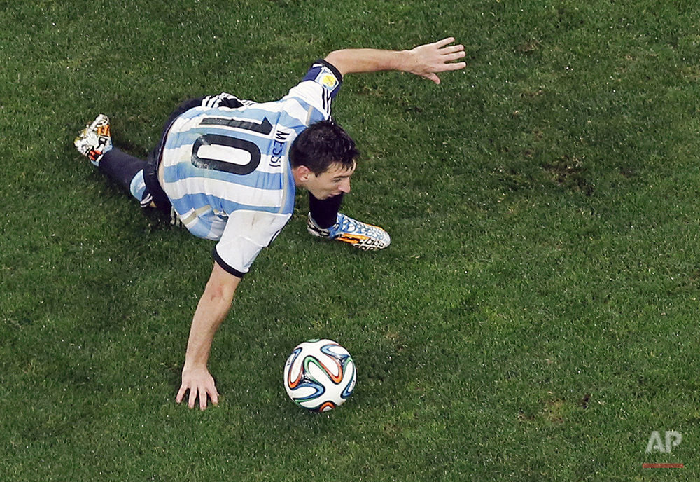 Argentina's Lionel Messi controls the ball during the World Cup semifinal soccer match between the Netherlands and Argentina at the Itaquerao Stadium in Sao Paulo, Brazil, Wednesday, July 9, 2014. (AP Photo/Fabrizio Bensch, Pool)