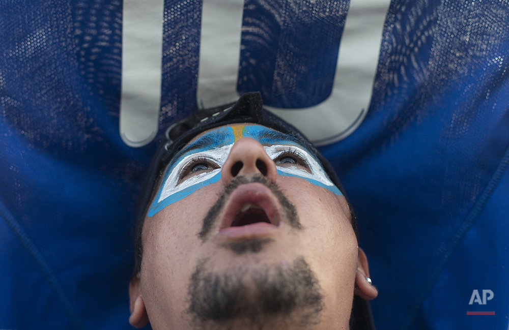 A soccer fan of the Argentina national soccer team watches a live telecast of the soccer World Cup semifinal match between Argentina and The Netherlands, inside the FIFA Fan Fest area on Copacabana beach, in Rio de Janeiro, Brazil, Wednesday, July 9, 2014. (AP Photo/Silvia Izquierdo)