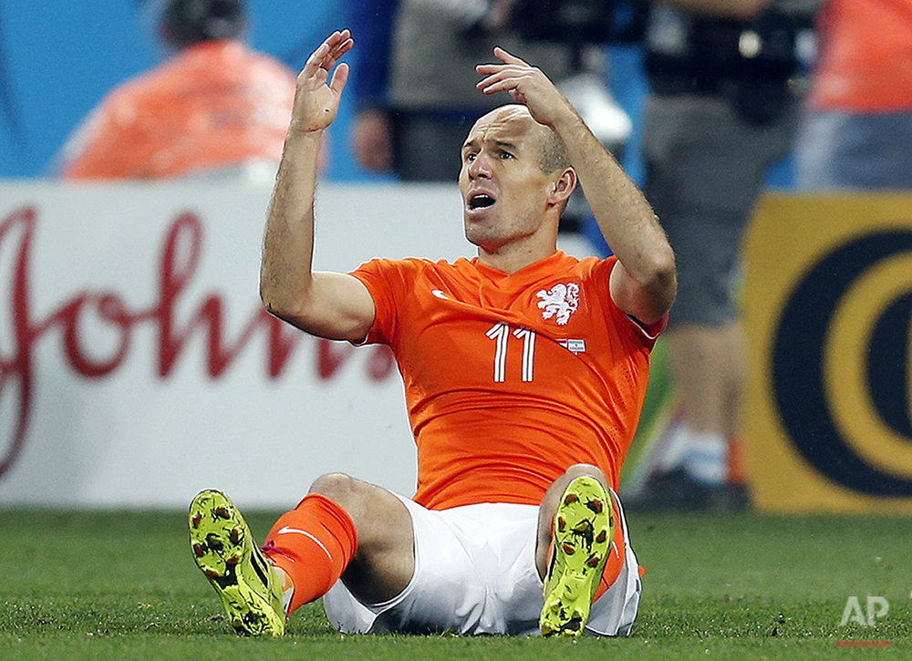 Netherlands' Arjen Robben gestures during the World Cup semifinal soccer match between the Netherlands and Argentina at the Itaquerao Stadium in Sao Paulo, Brazil, Wednesday, July 9, 2014. (AP Photo/Frank Augstein)