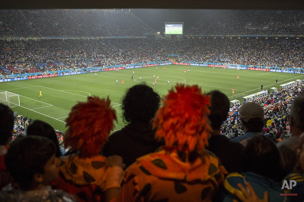Fans watch the World Cup semifinal soccer match between the Netherlands and Argentina at the Itaquerao Stadium in Sao Paulo Brazil, Wednesday, July 9, 2014.  Argentina reached the World Cup final on Wednesday after beating the Netherlands 4-2 in a penalty shootout.(AP Photo/Felipe Dana)