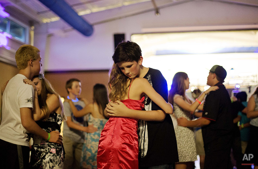 In this Thursday, July 17, 2014 photo, A.J. Dorough, 13, of Covington, Ga., right, slow dances with Kristin Moorehead, 13, of Tampa, Fla., on the final night at Camp Twitch and Shout, a camp for children with Tourette's Syndrome in Winder, Ga. (AP Photo/David Goldman)